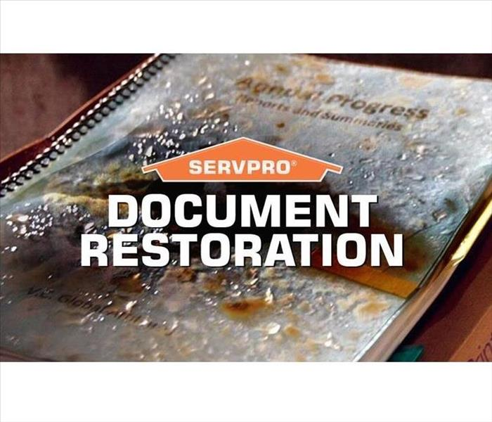 A binder full of documents has severe water damage. A graphic over the top reads Document Restoration